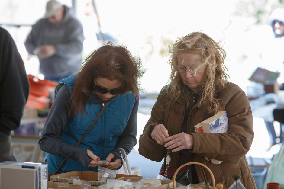 Gayle Wilkinson, left, and Sue Bolduc, both of Kensington, hunt for jewelry Saturday during the pre-Daffodil Festival weekend at Hubbard Park in Meriden. Justin Weekes, Special to the Record-Journal