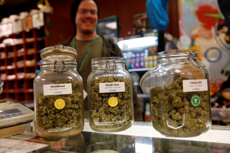FILE - In this Nov. 27, 2015, file photo, jars of marijuana buds sit on the counter at the Denver Kush Club in north Denver. (AP Photo/David Zalubowski)