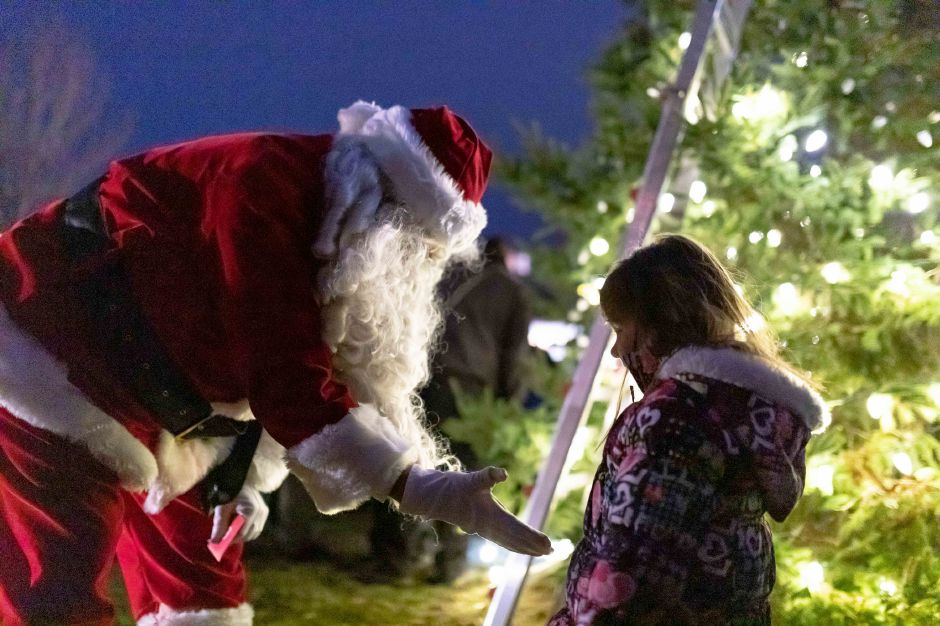 Santa Claus greets a girl after the holiday tree lighting at the Veterans Memorial Park in Berlin on Nov. 24, 2018. | Devin Leith-Yessian/Berlin Citizen