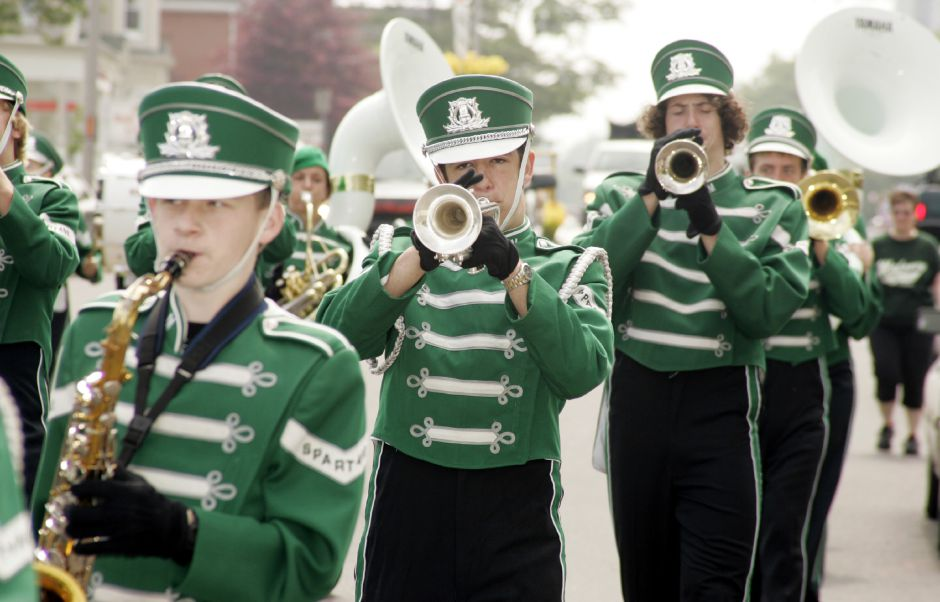 Members of the Maloney High School marching band play during Meriden
