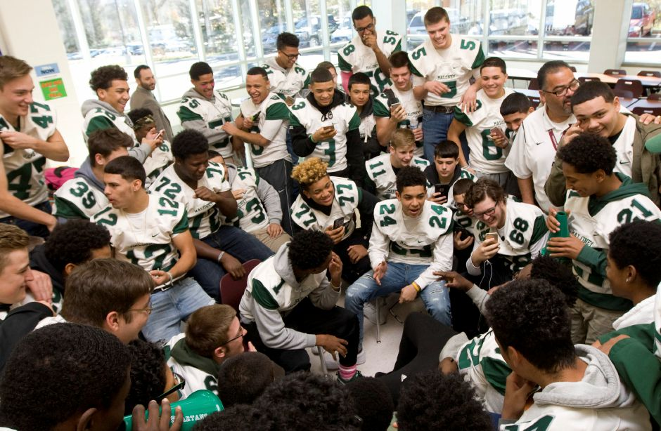 Maloney Spartans football team members get pumped up before the pep rally at Maloney High School, Wednesday, November 23, 2016. | Dave Zajac, Record-Journal