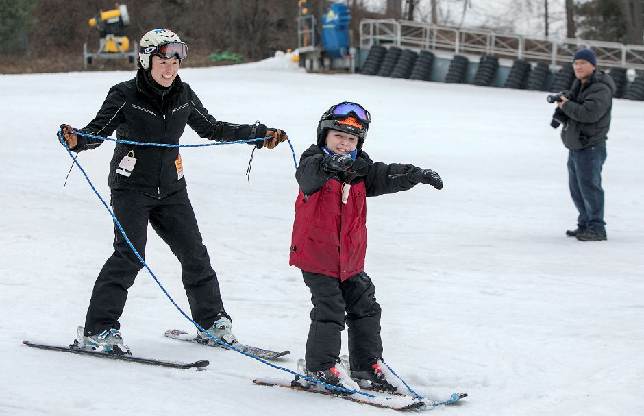 Instructor Alexis Lee, of New Haven, assists Tristan Schultz, 8, of Bristol, during the Connecticut Children