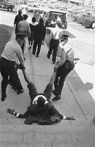 Rev. Avery Alexander of New Orleans is dragged feet first towards paddy wagon by police after he led an unsuccessful sit-in demonstration, Oct. 31, 1963 at City Hall in New Orleans. One group of blacks was arrested in the mayor?s office and Rev. Alexander?s group in the cafeteria in city hall. (AP Photo/Jim Bourdier)