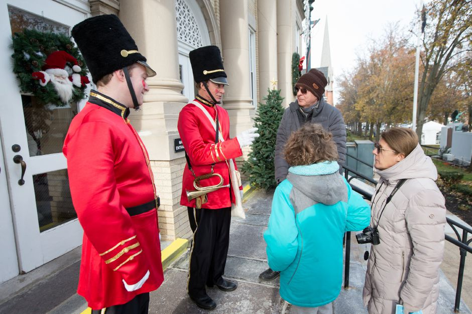 The Freemans are greeted by toy soldiers Mayor William Dickinson right and Sam Carmody Saturday during Season of Celebration at the Town Hall in Wallingford December 2, 2017 | Justin Weekes / For the Record-Journal