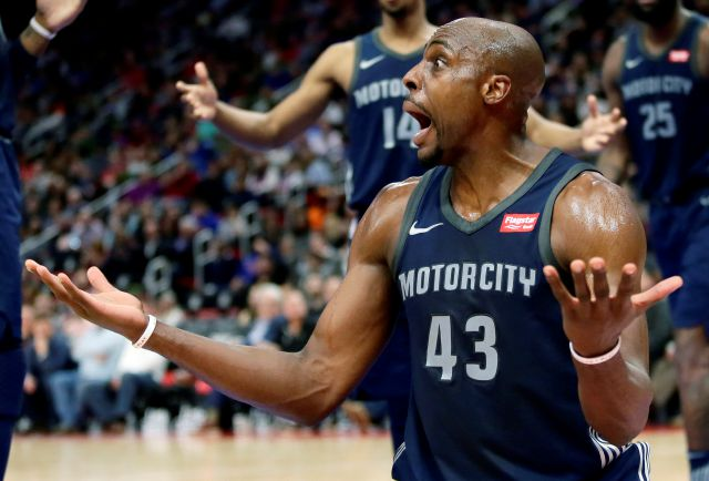 Detroit Pistons forward Anthony Tolliver (43) reacts after being whistled for a foul while blocking a shot by the Boston Celtics during the first half of an NBA basketball game Friday, Feb. 23, 2018, in Detroit. (AP Photo/Duane Burleson)