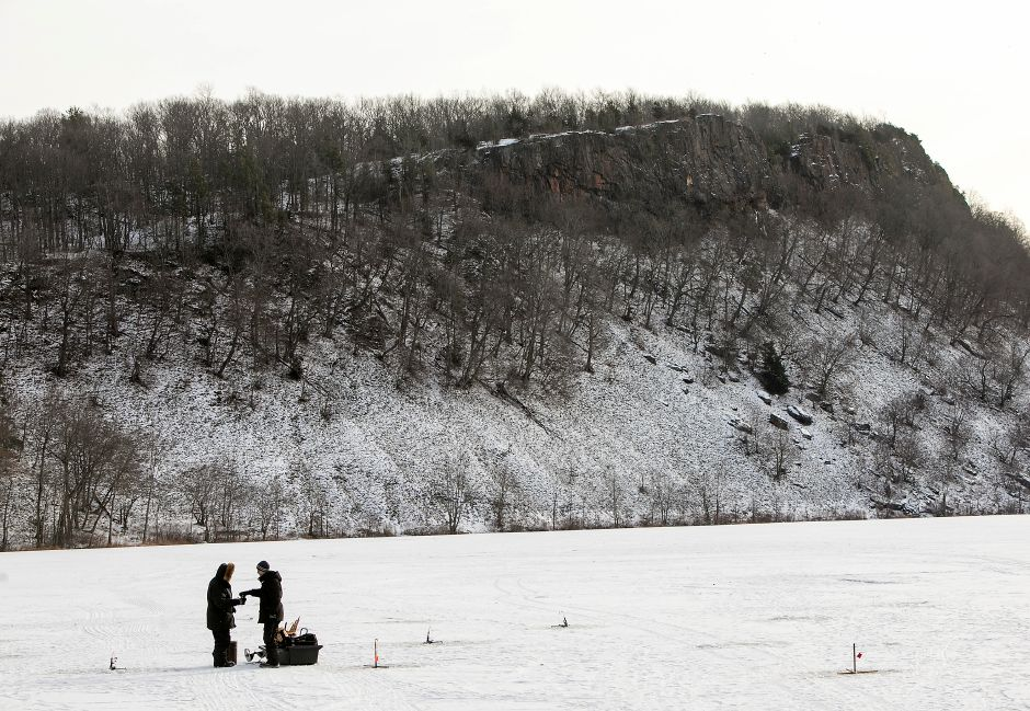 Tomas Zukowski, right, shares a hot beverage with father, Mark, while ice-fishing Black Pond in Middletown, Tuesday, Jan. 2, 2018. Dave Zajac, Record-Journal