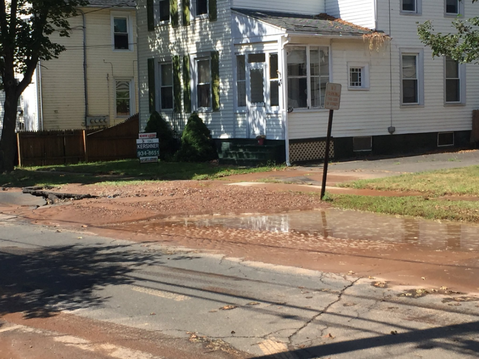 Emergency crews respond to a water main break on Valley Street in Wallingford Monday. | Bailey Wright, Record-Journal