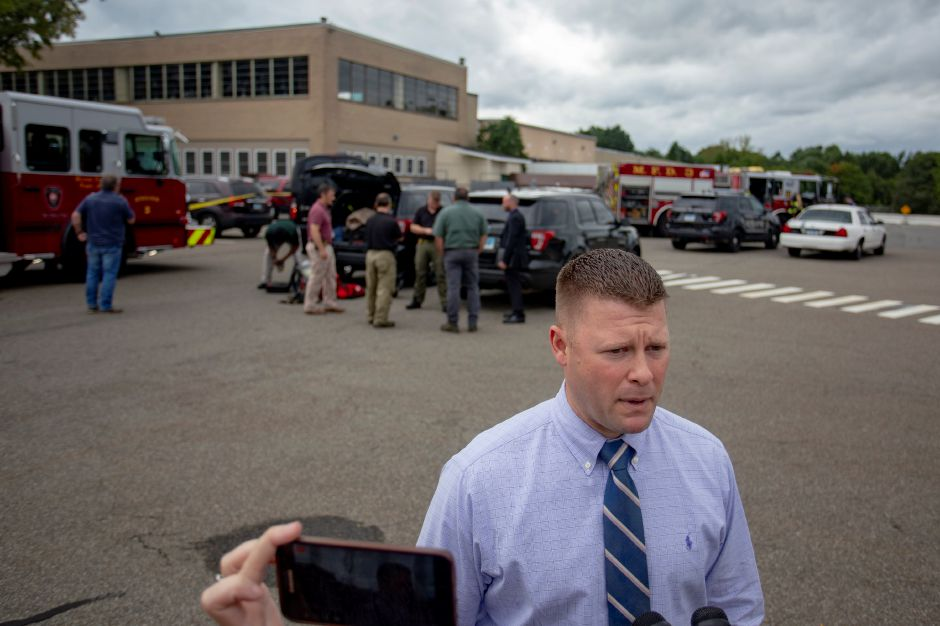 Meriden Police Lt. Christopher Fry addresses the media in the parking lot of 500 S. Broad St. in Meriden Sept. 21, 2018 after investigating a suspicious powder found in the mail room of The Money Source. | Richie Rathsack, Record-Journal
