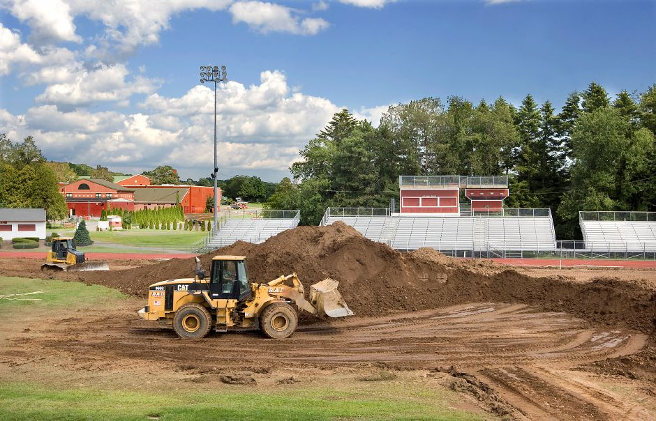 In this file photo, construction crews continue work on the Cheshire High School artificial turf field project Wednesday August 17, 2011. (Dave Zajac/Record-Journal)