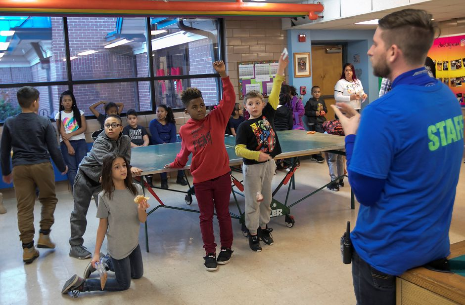 Josh Lovely, director of operations, goes over club guidelines with children at the Meriden Boys & Girls Club  on Wednesday.