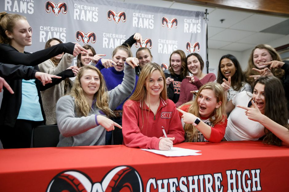 Backed by teammates and friends Friday, Cheshire High School senior Jillian Klem signs her National Letter of Intent to play soccer at Sacred Heart University. Klem heads to Division I soccer after a senior season that couminated with All-Conference and All-State selection. She also played in the Senior Bowl. | Justin Weekes / Special to the Record-Journal