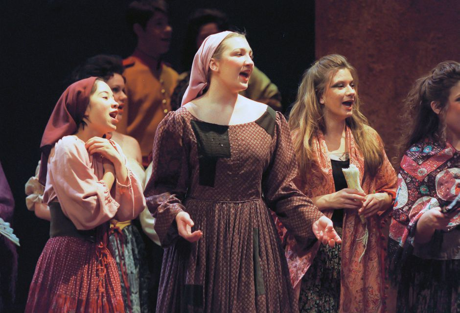 "RJ file photo - Michelle Ferguson, 16, center, of Sheehan High School in Wallingford, has a part in the chorus of the opera ""Carmen"" at the University of Hartford"