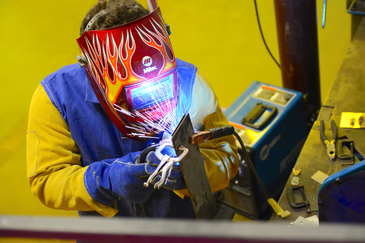 Avery Thomas, of Grasso Technical High School, welds metal during a Skills USA competition at Wilcox Technical High School on Friday, March 31, 2017. | Bryan Lipiner, Record-Journal