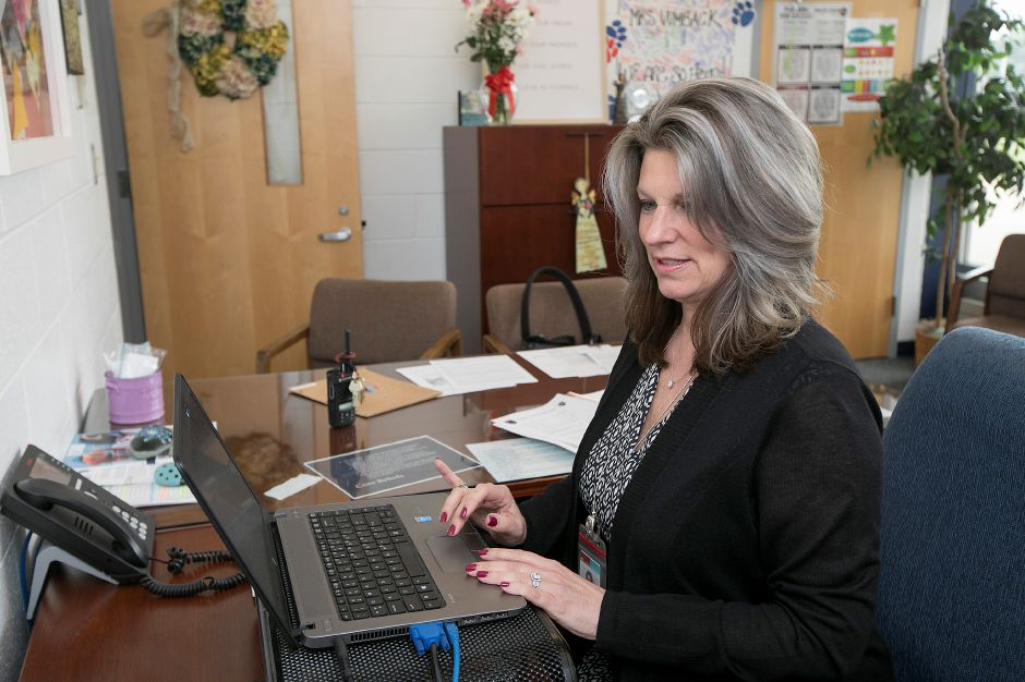 Lincoln Middle School Principal Dianne Vumback works at her desk, Monday, May 14, 2018. Vumback has been named the Connecticut Association of Schools 2018 Middle School Principal of the Year. Dave Zajac, Record-Journal