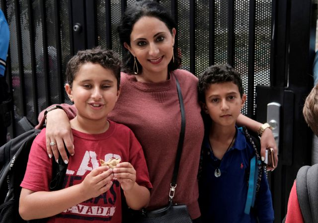 "In this Monday May 13, 2019 photo Evelyn Lahiji, picks up her sons, after school second-grader Lorenzo Naghdechi, 8, right, and third-grader Leonardo Naghdechi, 9, at Horace Mann School in Beverly Hills, Calif. Lahiji, said ""I"