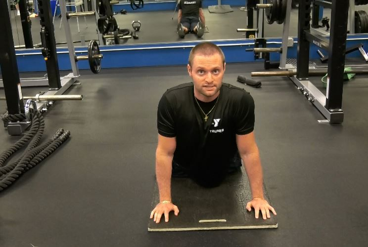 Personal trainer John Pamieri of the Wallingford YMCA gives tips for student athletes to prepare for the fall season, Mon., Aug. 13. | Ashley Kus, Record-Journal