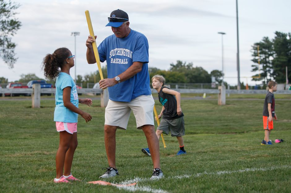 As Southington baseball coach Charlie Lembo watches in the background,  Natalia Gause, 7, gets the bat on the ball. Justin Weekes, Special to the Record-Journal