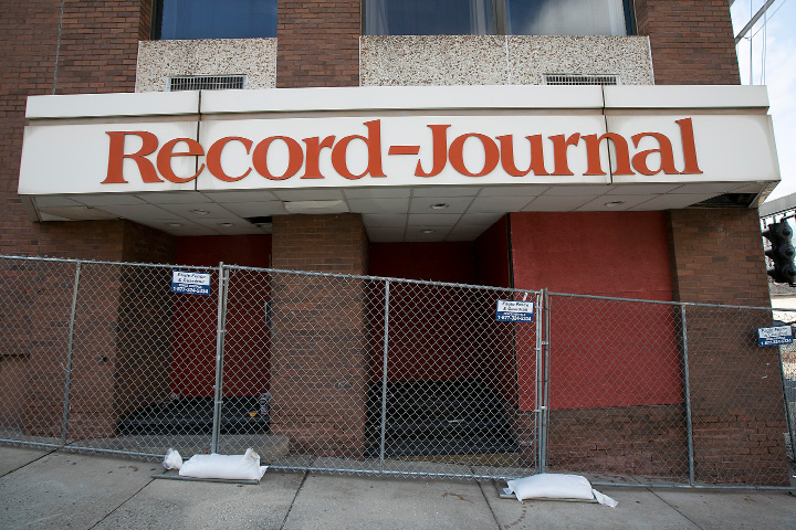 Fencing has been installed around the former Record-Journal building at 11 Crown St. in Meriden, Tuesday, February 28, 2017.  | Dave Zajac, Record-Journal
