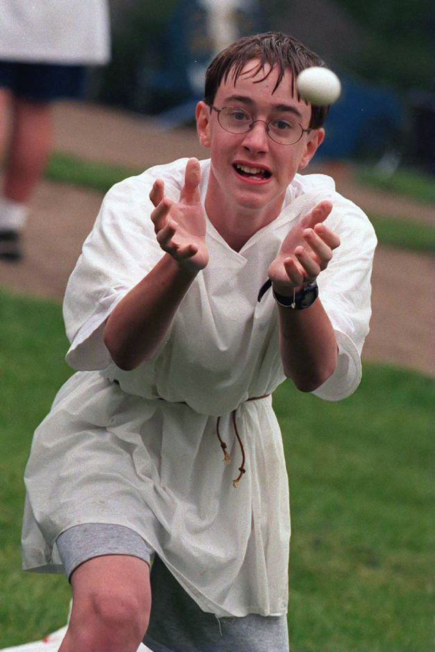 RJ file photo - Clad in a toga, Platt eighth-grader Frank Mohr, 13, makes a catch during the egg toss event May 18, 1999.