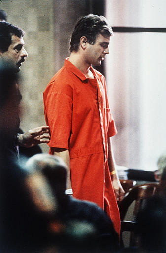 Accused serial killer Jeffrey L. Dahmer leaves the courtroom after a preliminary hearing appearance in Milwaukee, Wis., on Aug. 22, 1991.  Dahmer is charged with three more counts on dismemberment slayings in Milwaukee.  Dahmer waived his rights to the preliminary hearing.  (AP Photo/Mark Elias)