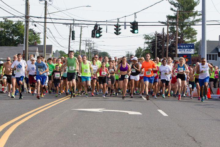 Runners leave the start on East Street Sunday during the GE 5 K Petit Road Race to benefit the Petit Family Foundation in Plainville Jul. 17, 2016 | Justin Weekes / For the Record-Journal