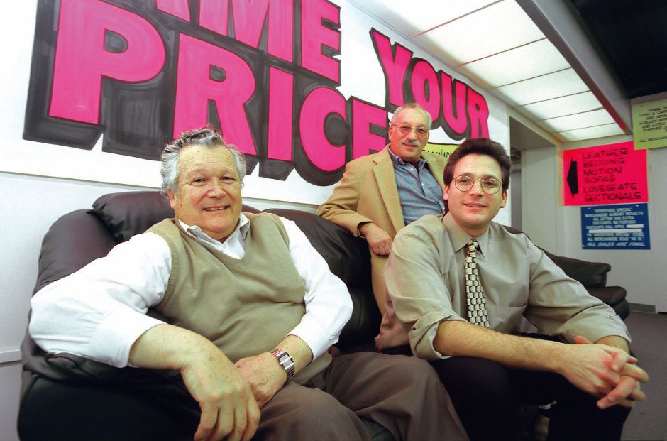 RJ file photo - From left, Herb, Leo and Stven Bichunsky, principals of Meriden Auction Rooms, which is to close forever Dec. 6, 1998.