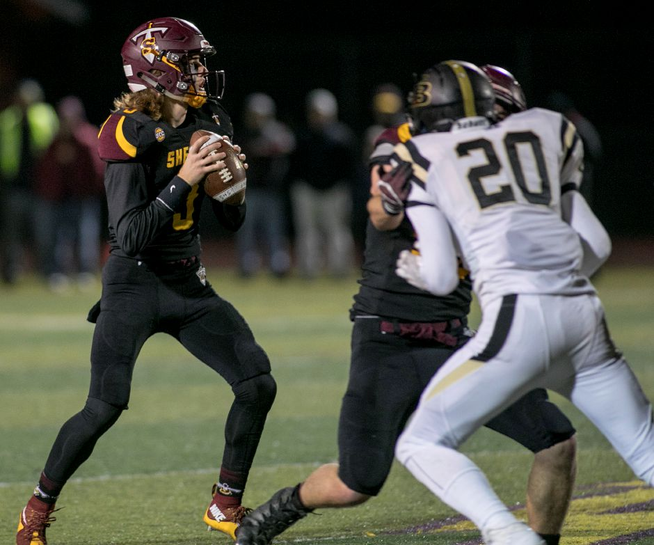 Sheehan quarterback Weston Terzi looks for an open receiver during the second half of the Class M quarterfinals at Sheehan High School, Tuesday, Nov. 28, 2017. | Dave Zajac, Record-Journal