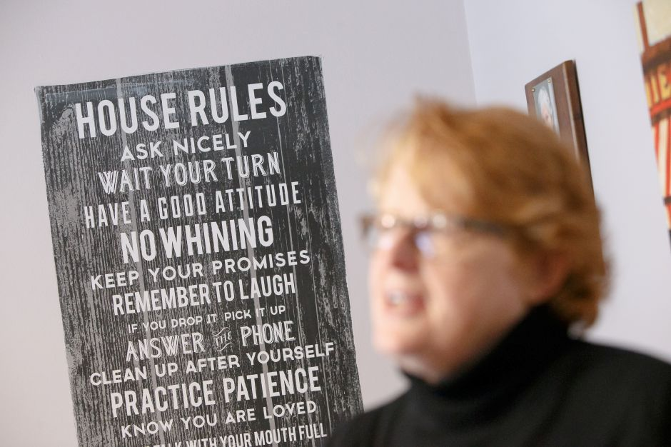 "A ""House Rules"" sign provides a structure for daily living to help residents at the Bridge Family Center Winifred House in Southington. File photo,
