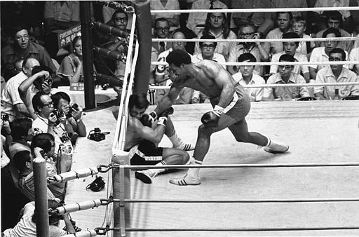 World heavyweight champion George Foreman gives a right hook to Puerto Rican challenger Joe King Roman, who is already on the floor, in Tokyo on Sept. 1, 1973. This action by Forman produced a controversy and Roman