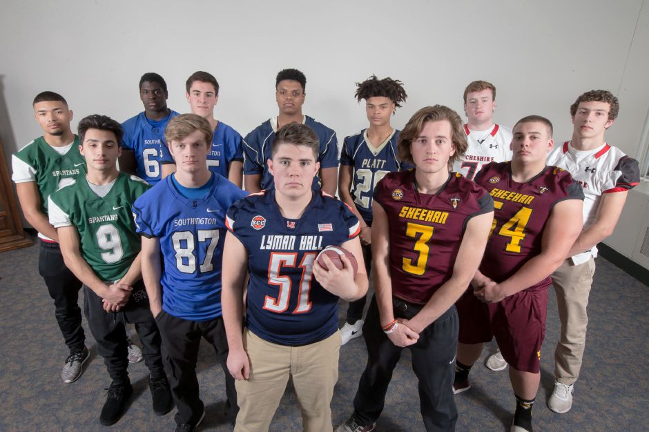 Introducing the offensive unit of the All-Record-Journal Football Team. Front and center is Lyman Hall's Andrew McClure. He is flanked, left to right, by Maloney's Aden Valentin (No. 9), Southington