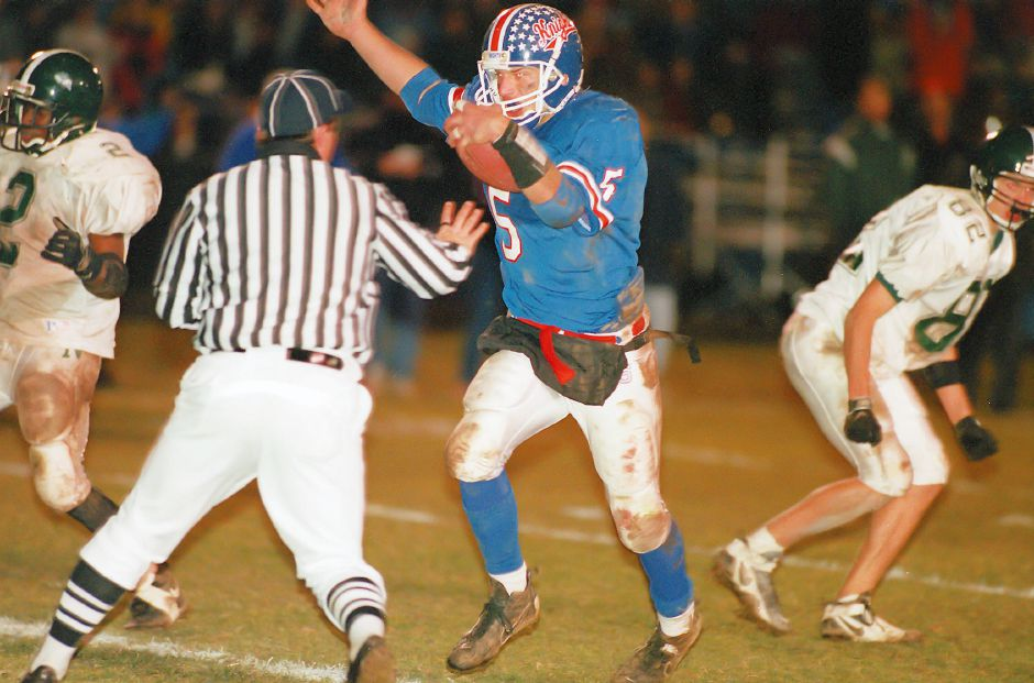 As the referee gets out of his way, Southington wide receiver Glenn Parciak crosses the goal line for a crucial insurance touchdown with 6:25 left in the game Dec. 1, 1998.