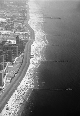 A crowd estimated at more than one and one-half million persons by Police Capt. Walter Winter-Halter, swarm on the sandy beach and in the surf at Coney Island, New York on August 29, 1948, in effort to escape fifth day of the heat wave which kept temperatures in the nineties. (AP Photo)