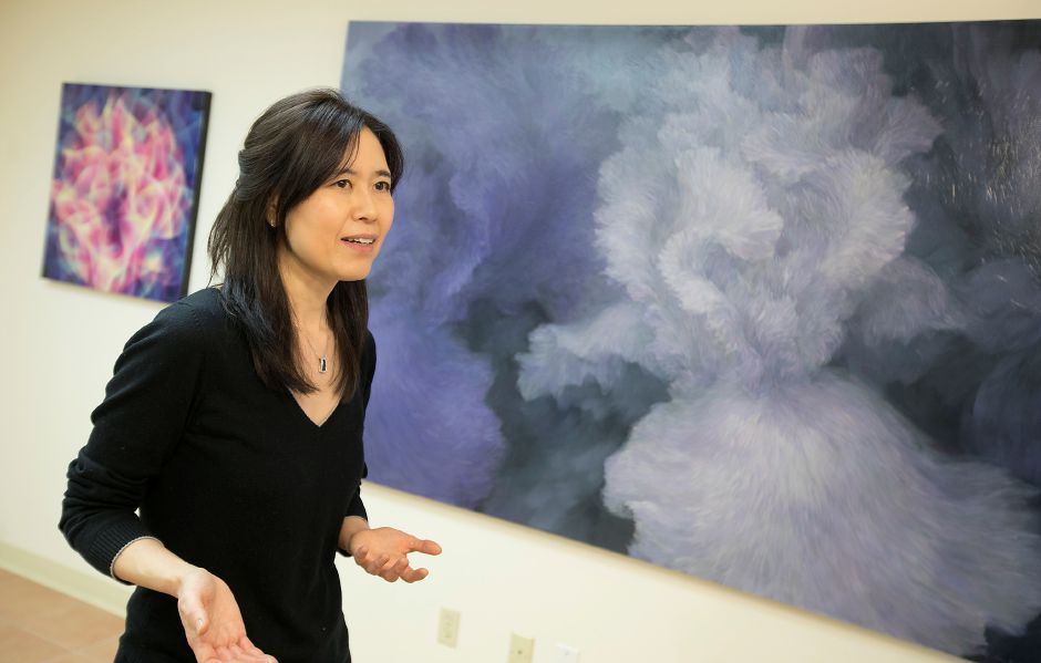 Hannah Jung, founder of The Voice of Art Gallery and Studio, talks about the non-profit that opened earlier this month at 2 Town Center in Cheshire, Tuesday, Jan. 23, 2018. Jung is hoping to showcase art that