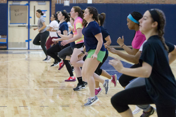 Members of the Platt softball team warm up for a indoor practice in the newly finished gym Monday at Platt High School in Meriden Mar. 27, 2017 | Justin Weekes / For the Record-Journal