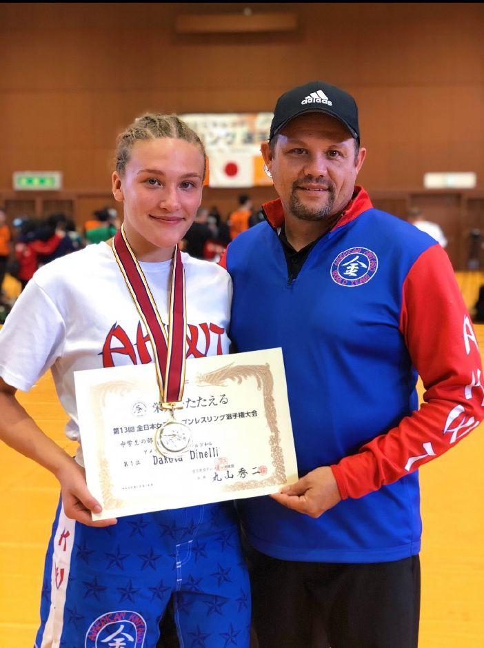 Plainville resident Dakota Dinielli, left, took first place for her division in the All Japan Female Open in October. She is the first member of the American Kinparo World Team, led by Travis Carpenter at right, to win the tournament. | Image courtesy of Kim Danielli