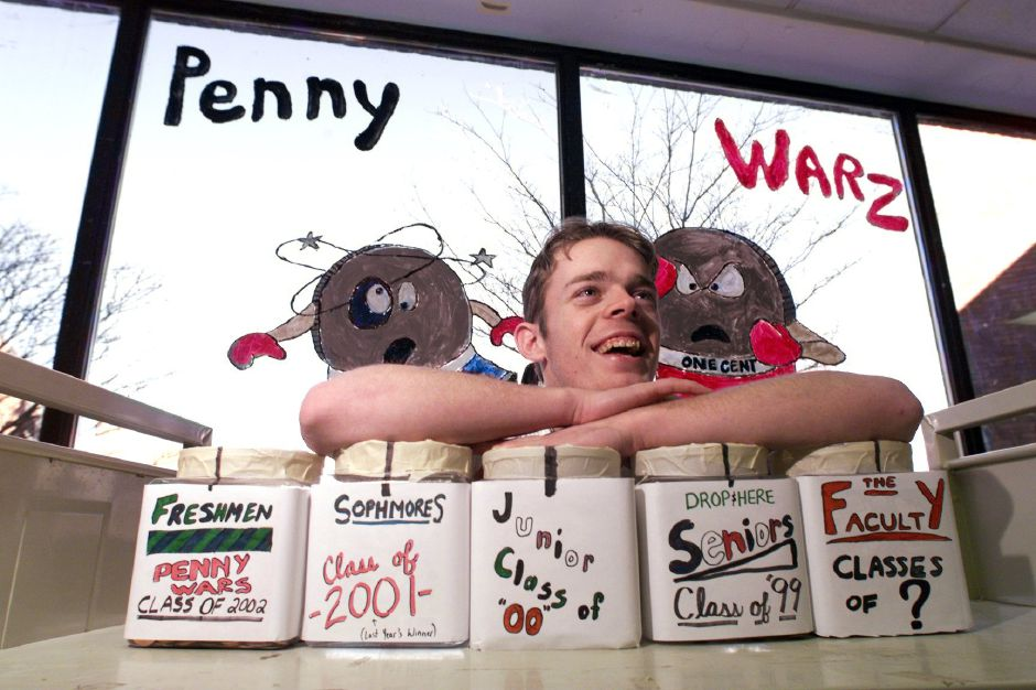 "RJ file photo - Dave Olsen, vice president of the Southington High School Future Business Leaders of America, rests on jars of coins that the club is using to collect money for the March of Dimes, March 1999. They called their fundraising effort ""Penny Warz."""