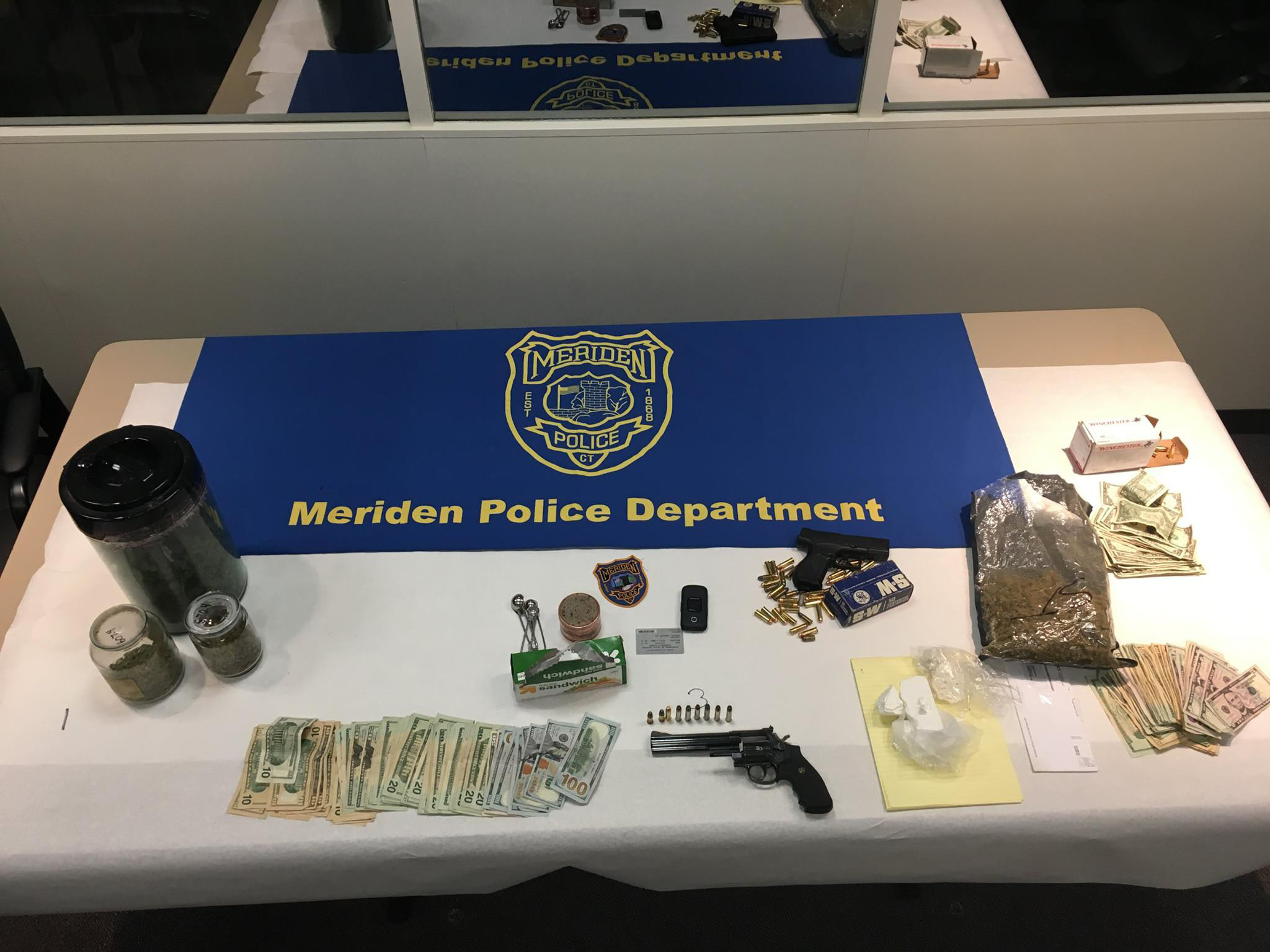FILE PHOTO -- Drugs and other property seized during an investigation by Meriden police.