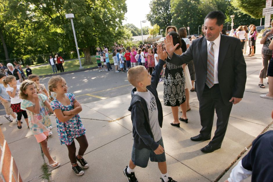 "Wallingford School Superintendent Salvatore Menzo, right, says ""nice shirt"" high fiving student Zach Fazzino, 8, sporting a yankees logo on the first day of school at Yalesville School September 1, 2009. (dave zajac photo)"