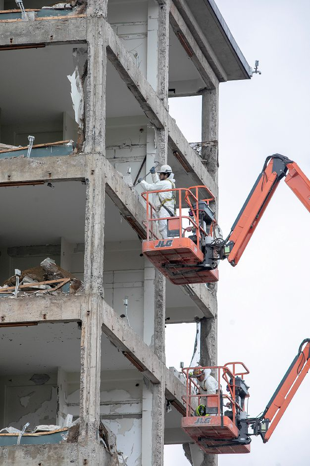 Crews continue demolition of the former Mills Memorial apartment buildings on Cedar Street in Meriden, Mon., Nov. 5, 2018. Dave Zajac, Record-Journal