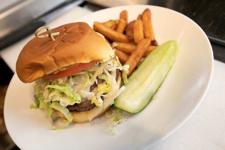 Tavern double-double burger on the menu at Amici Tavern, 43 Broadway, North Haven, Wed. Feb. 6, 2019. Dave Zajac, Record-Journal
