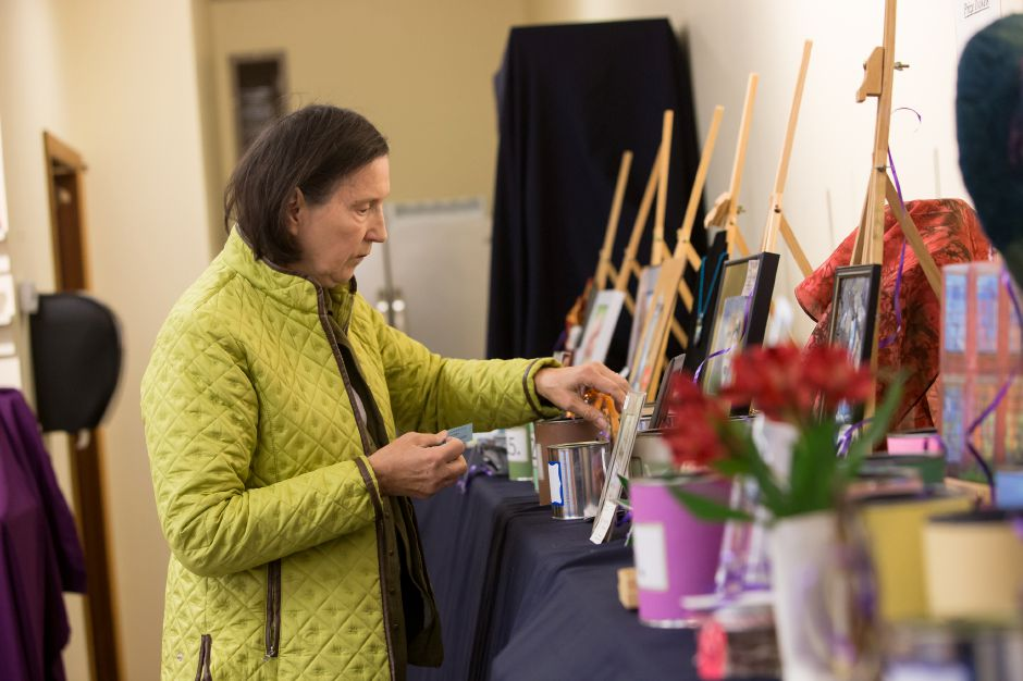 Mary Ann Nelson of Cheshire makes a selection in the raffle Sunday during the Artspace Marketplace at Artspace in Cheshire. November 18, 2018 | Justin Weekes / Special to the Record-Journal