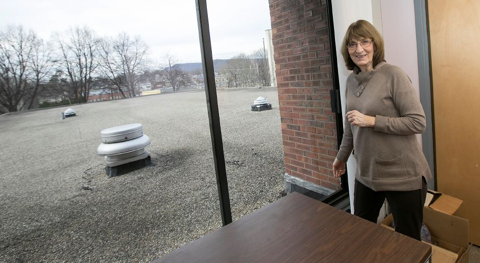 Karen Roesler, library director, stands in a second floor office overlooking the roof over the children