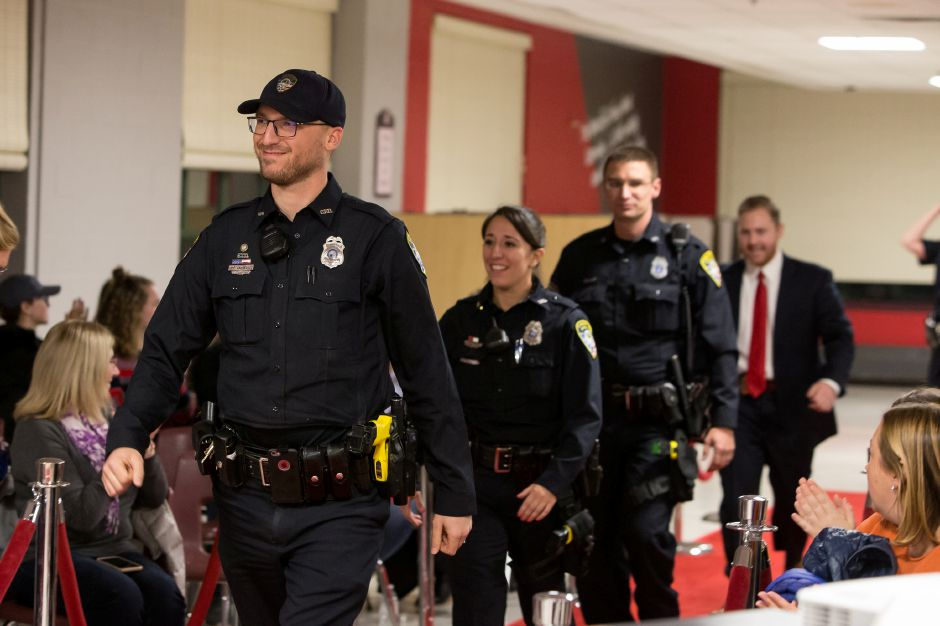 Cheshire police officers walk the red carpet at Cheshire High School before the viewing of the Cheshire Police Department Lip Sync Challenge video premiere. For more photos, visit www.myrecordjournal.com, Justin Weekes, Special to the Record-Journal