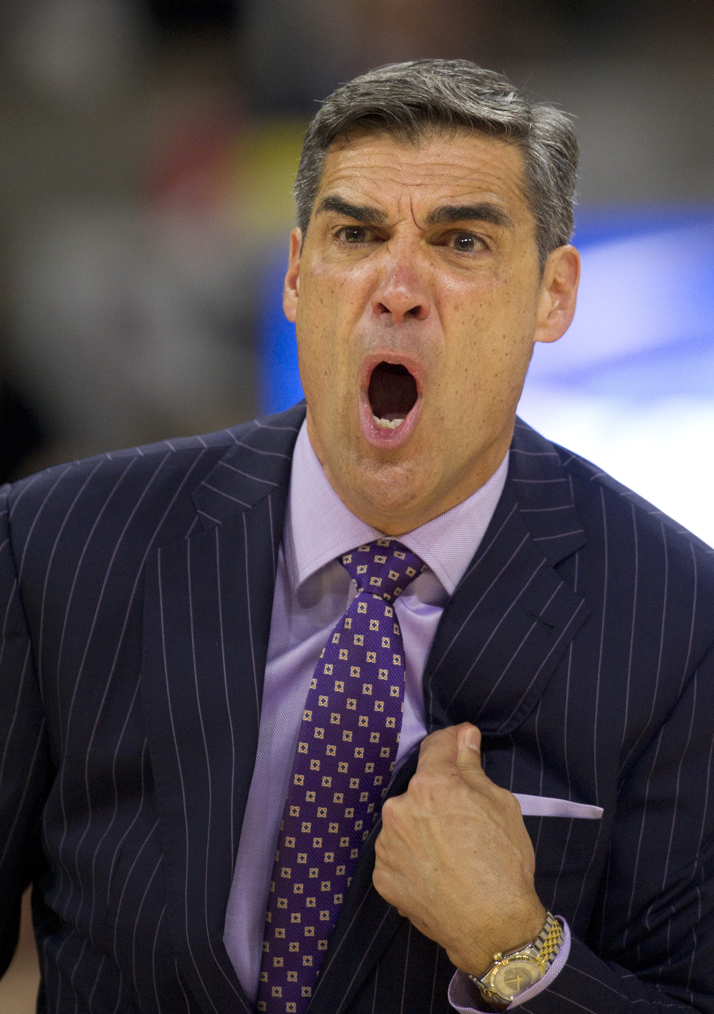 FILE - In this Feb. 6, 2016, file photo, Villanova head coach Jay Wright yells at an official after a call in the first half of an NCAA basketball game against Providence, in Providence, R.I. Wright recounts Villanova