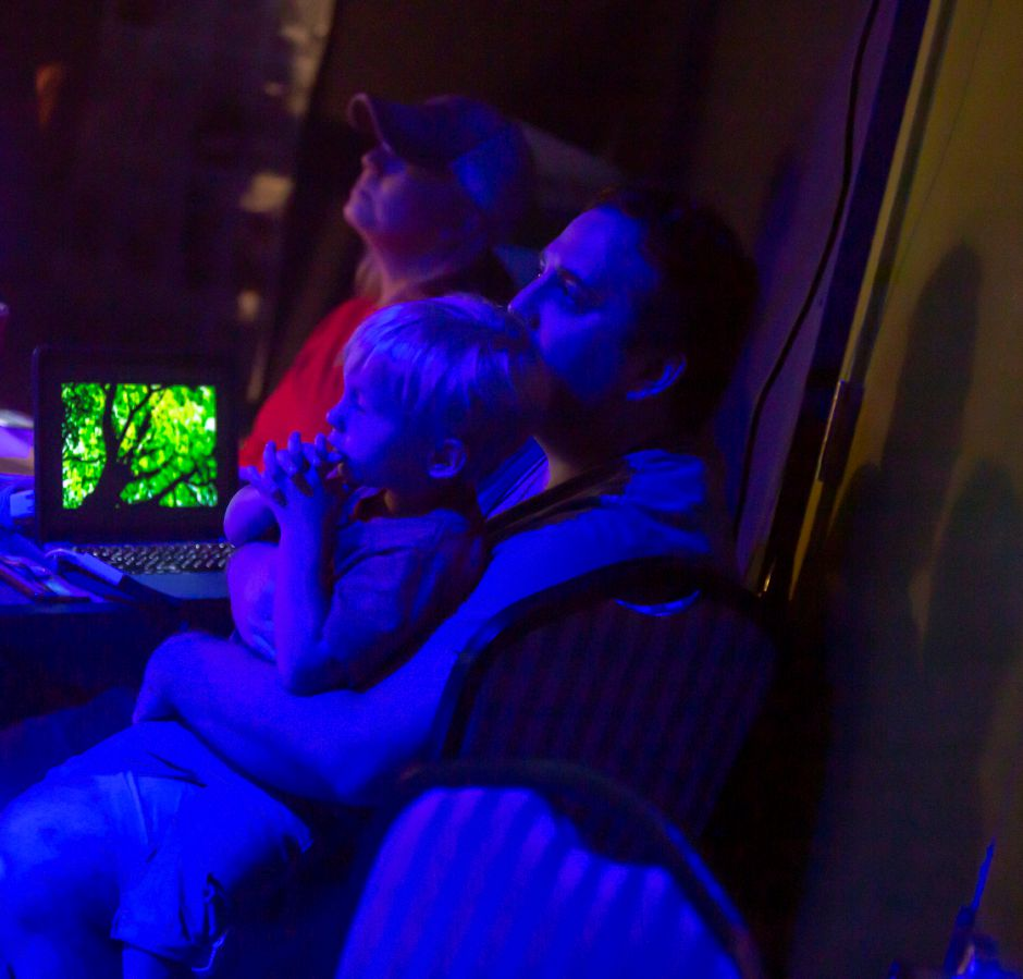 Patrick Laffin and his son Jamie, 4, watch the preview show of Tarzan at the Square Foot Theatre in Wallingford Aug. 7, 2019. | Richie Rathsack, Record-Journal