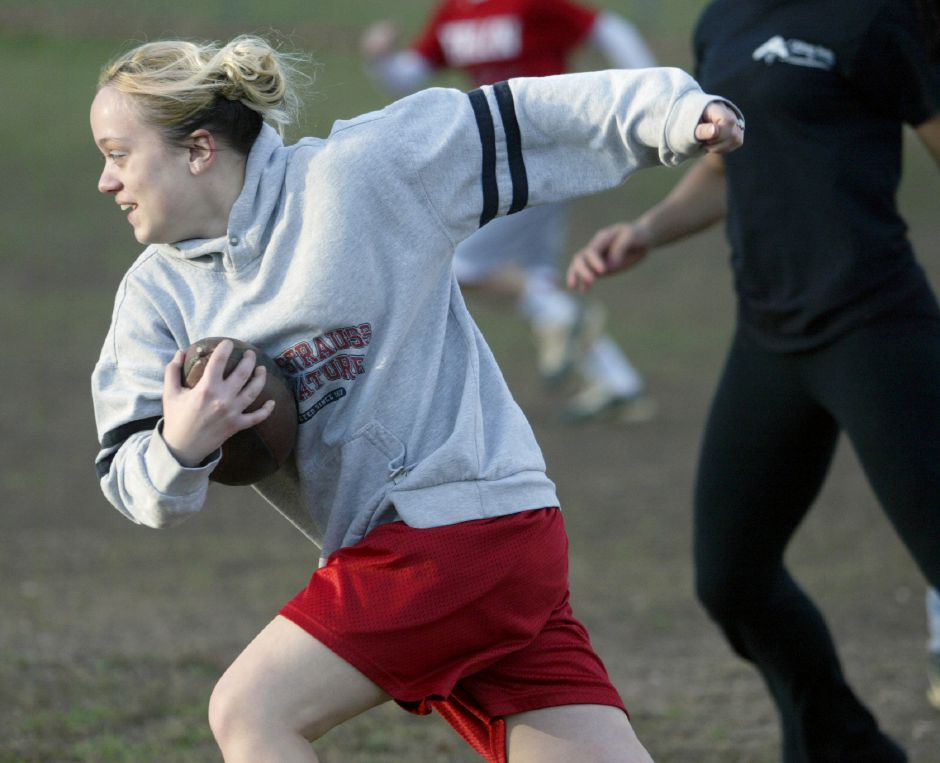 MERIDEN, Connecticut - Wednesday, November 4, 2009 - Wilcox Tech Powder Puff player Amy Ayala runs through the defense during practice from Wilcox Tech on Wednesday, November 4. Rob Beecher / Record-Journal