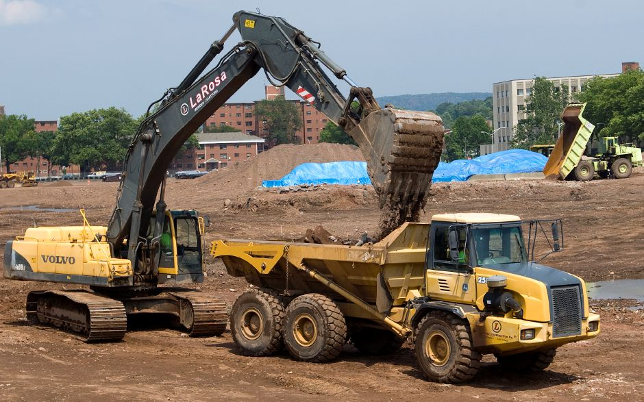LaRosa Construction crews continue work on the Hub site in downtown Meriden, Tuesday, July 8, 2014. Some tenants of the Mills Memorial apartments nearby are concerned over dust from the construction site. | Dave Zajac / Record-Journal