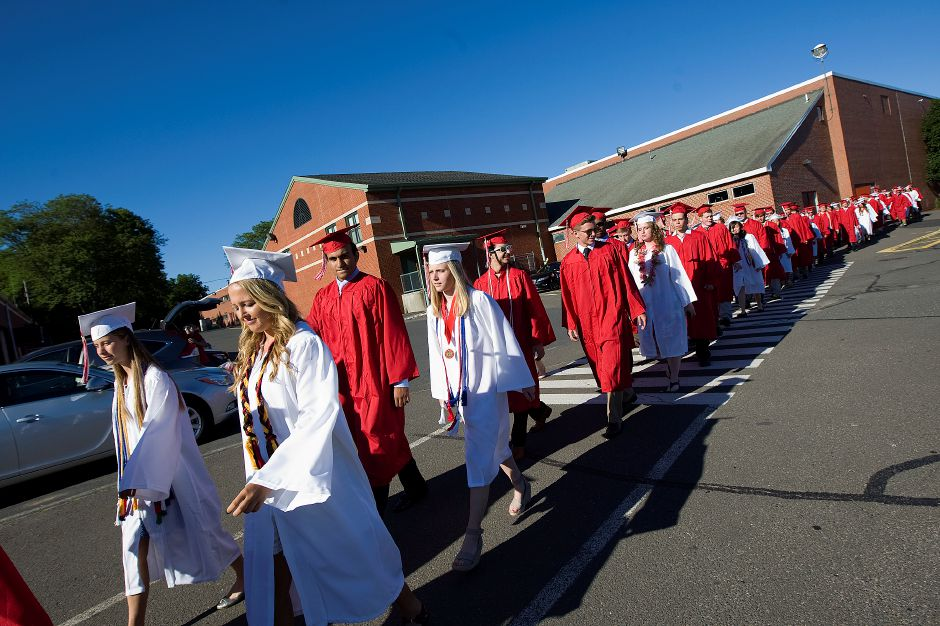 Cheshire graduates head out of the school during the processional march to graduation ceremonies at Cheshire High School, Friday, June 10, 2016. | Dave Zajac, Record-Journal