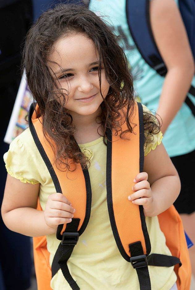 Arwa Saleh, 5, of Meriden, smiles after receiving her backpack during the annual Back to School Expo at the Meriden Green, Tuesday, August 21, 2018. Dave Zajac, Record-Journal