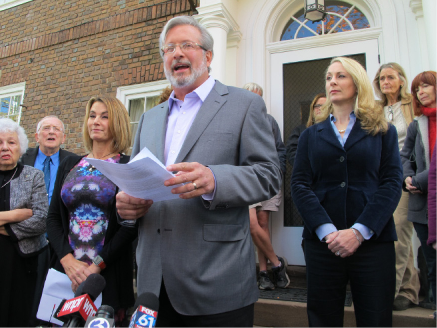 Dr. William Petit, then a legislative candidate, is flanked by state House Minority Leader Themis Klarides, R-Derby, left, and his wife, Christine, as he speaks to the media in October 2016 outside his home in Plainville.| File photo, Associated Press